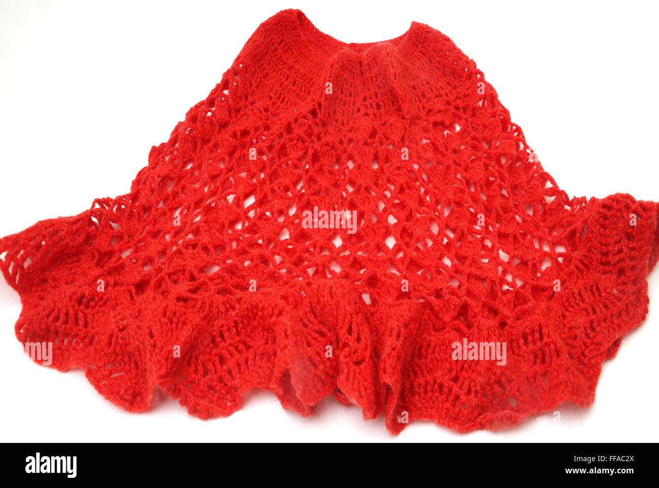 Red Knitted Wool Poncho - Stock Image