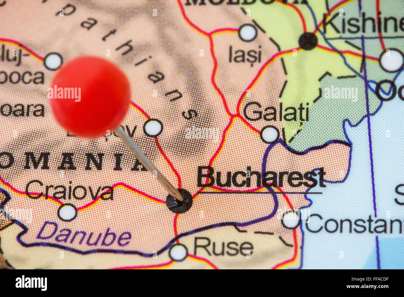Close-up of a red pushpin in a map of Bucharest, Romania ...