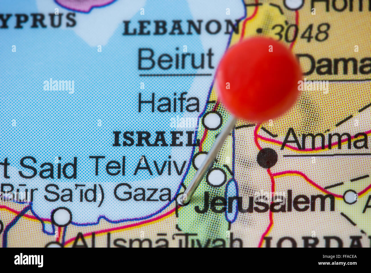 Close-up of a red pushpin in a map of Gaza, Palestine. - Stock Image