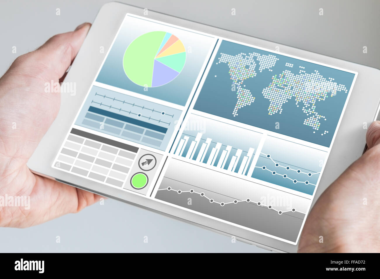 Business man holding modern tablet with both hands with business dashboard in neutral color - Stock Image