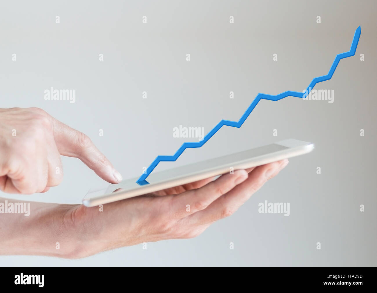Hand Holding Tablet Concept Of Increasing Sales From Mobile Online