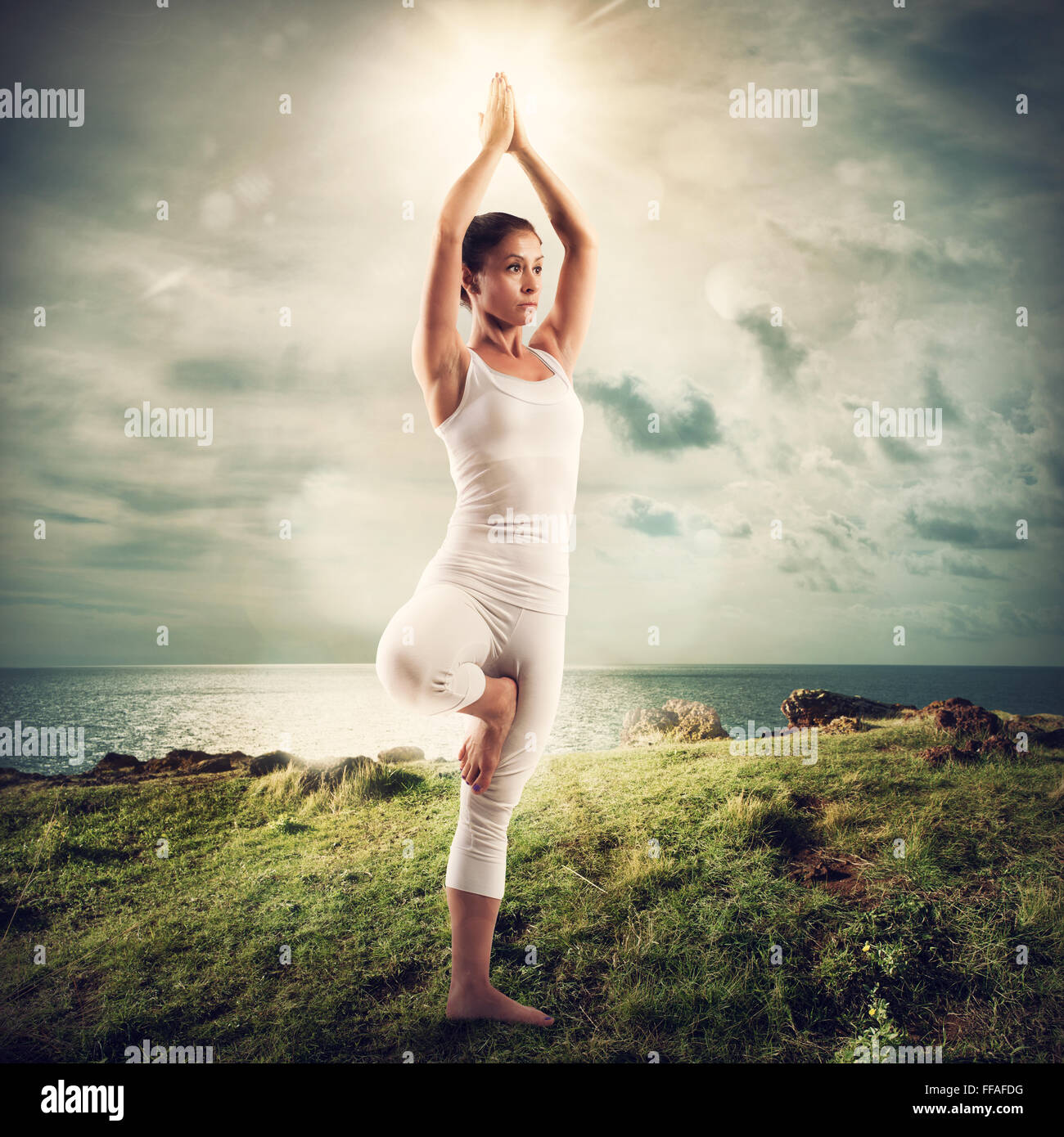 Yoga in a natural landscape - Stock Image