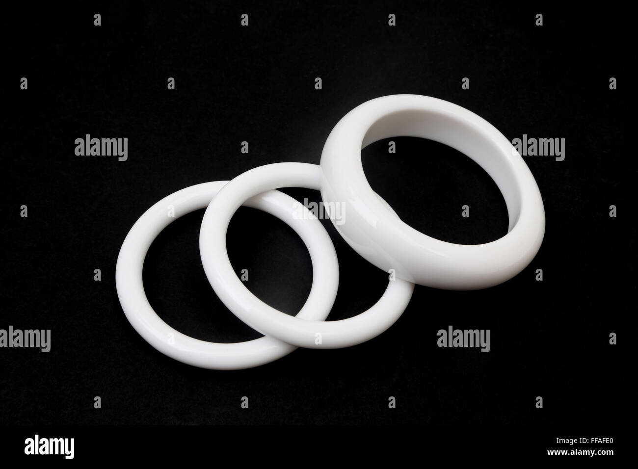 Dress Jewellery -  Three White Plastic Bangles - Stock Image