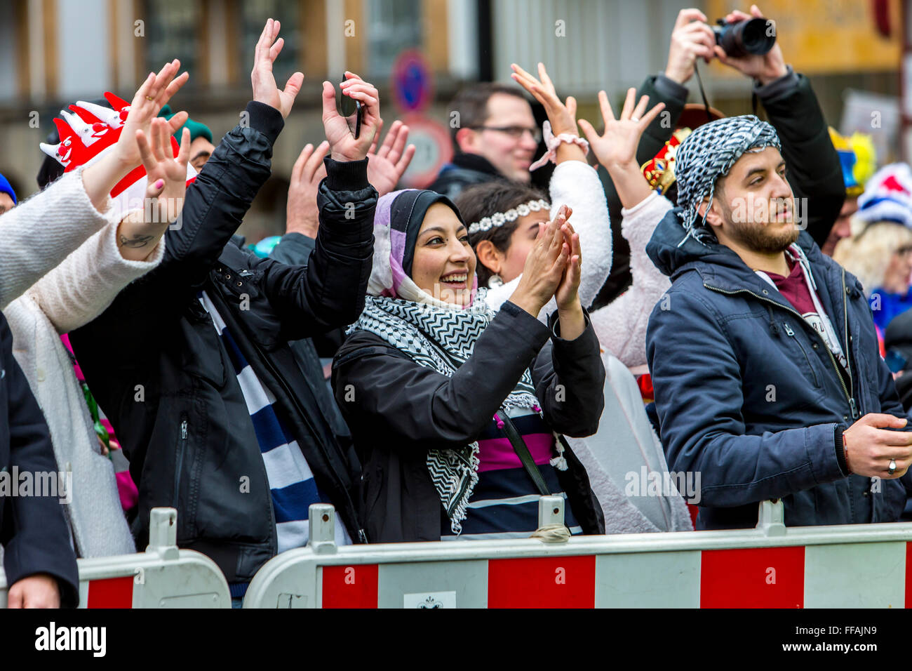 Street carnival parade and party in Cologne, Germany, at Carnival Monday, Shrove Monday, Rose Monday, people in Stock Photo