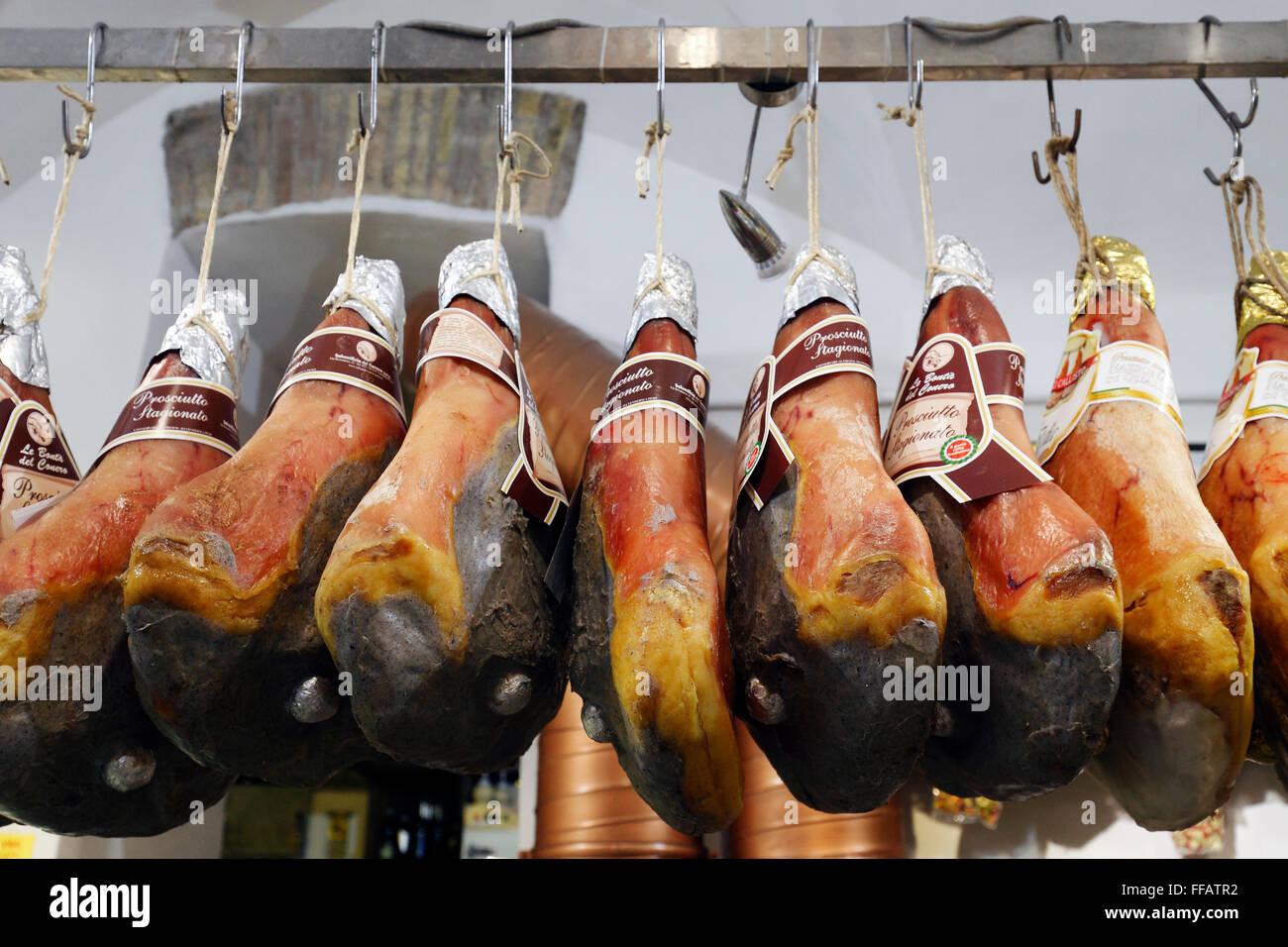 Parma hams in a deli, Rome, Italy - Stock Image