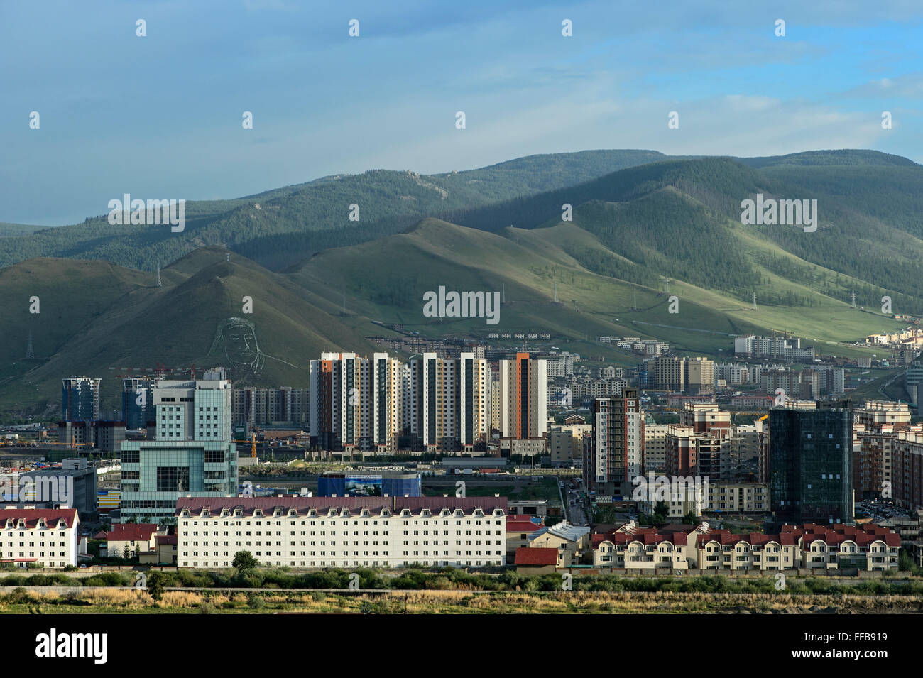 View of modern residential district, behind mountains Bogd Khan with portrait of Genghis Khan, Ulan Bator, Mongolia - Stock Image