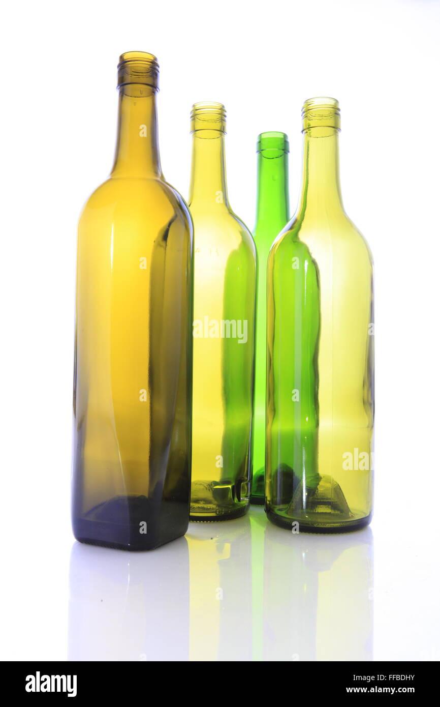 Four Empty Wine Bottles on a white background Stock Photo