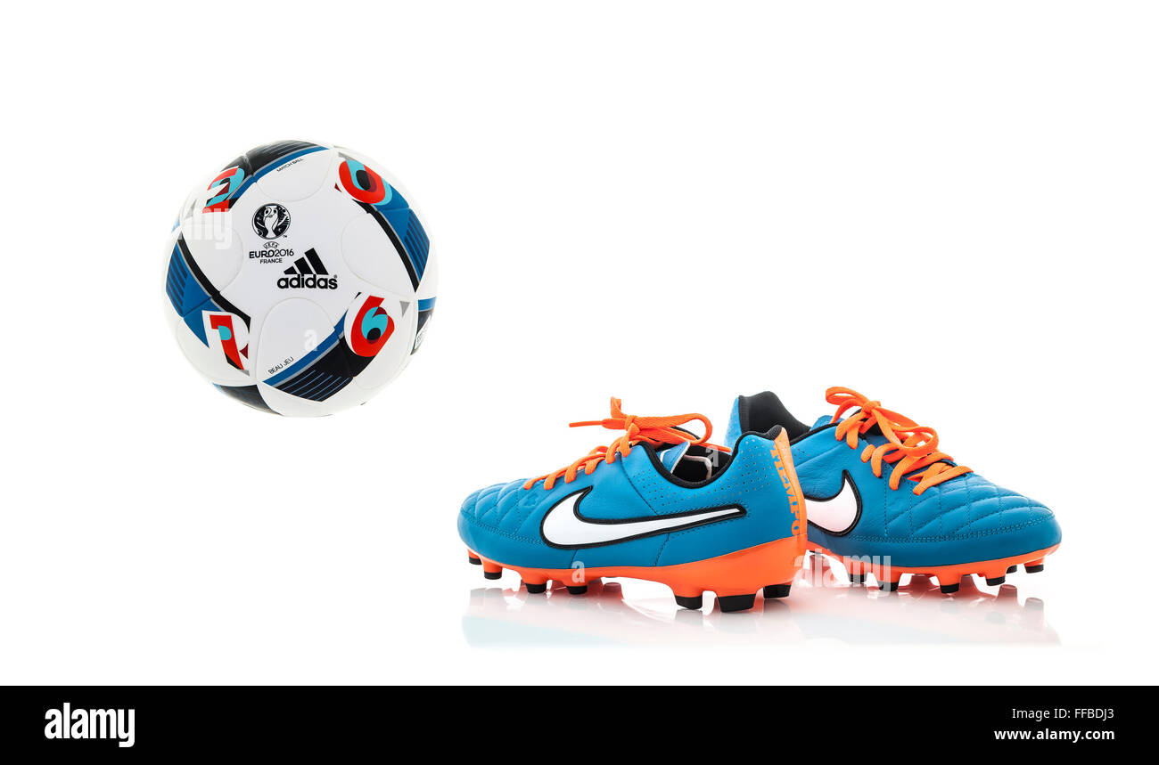 Adidas BEAU JEU 2016 Euro football with A Pair of Nike Football Boots on a White Background - Stock Image