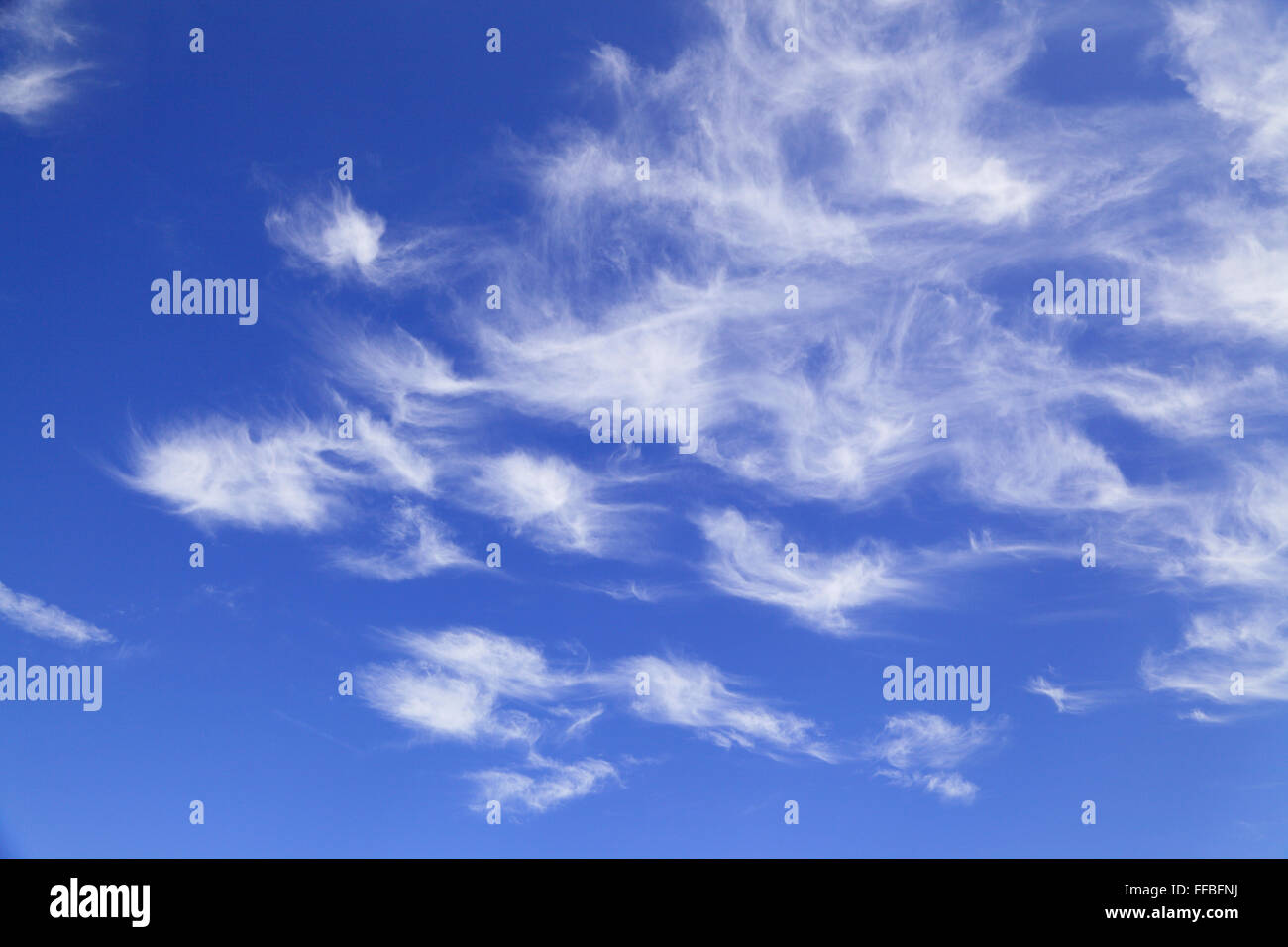 Wispy clouds in a blue sky - Stock Image