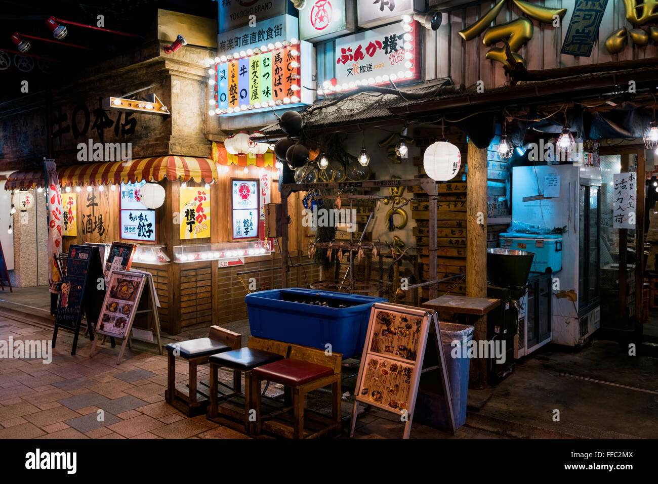 Tokyo, Japan - January 21, 2016: Japanese restaurants at the Yakitori Alley in Yurakucho Under the JR Yamanote Tracks. - Stock Image