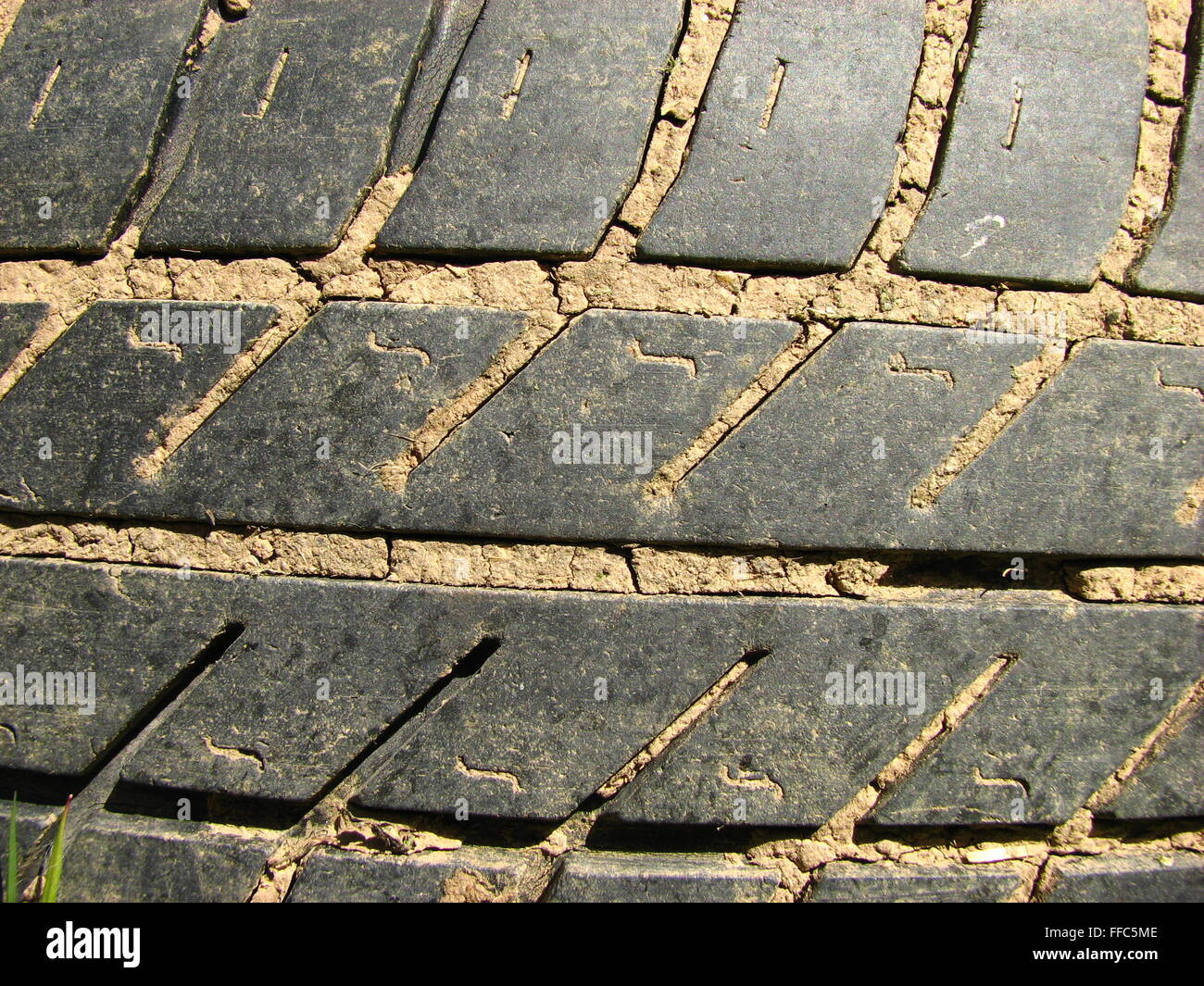Close-up of a worn and muddy tire profile - Stock Image