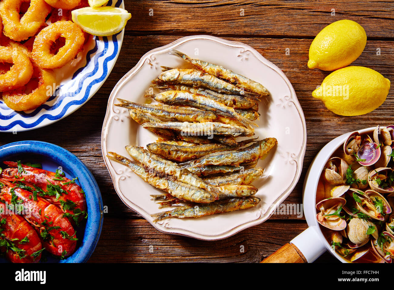 Tapas spanish seafood clams shrimps calamari romana and fried anchovies fish Stock Photo