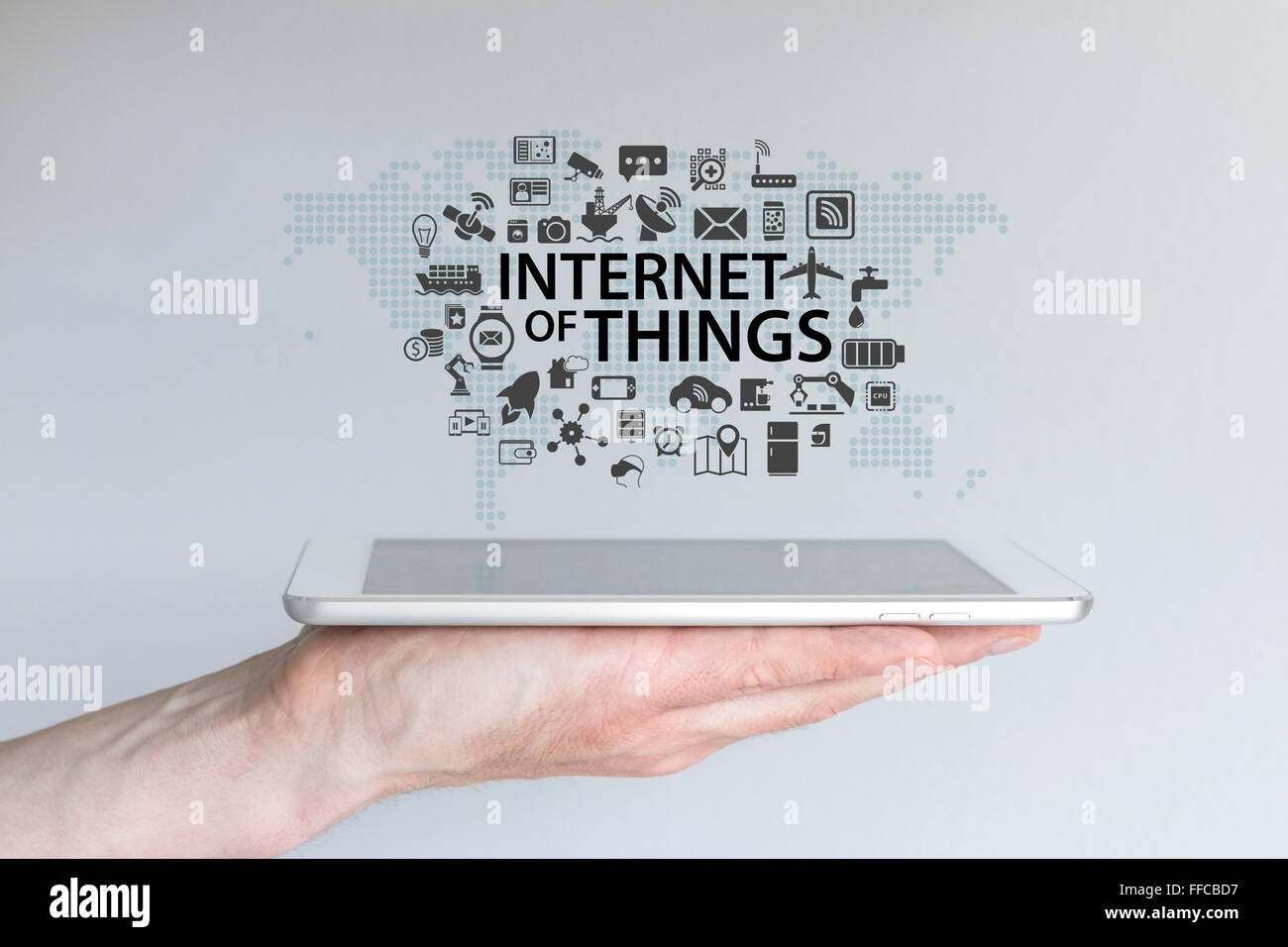 Hand holding tablet or modern smart phone. Internet of things (IOT) background concept. - Stock Image