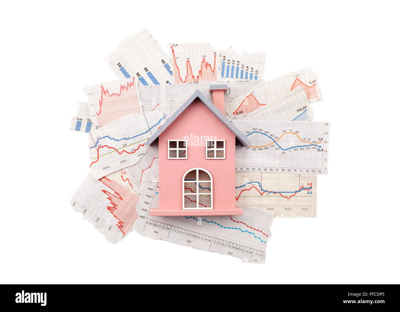 House on newspaper charts with clipping path - Stock Image