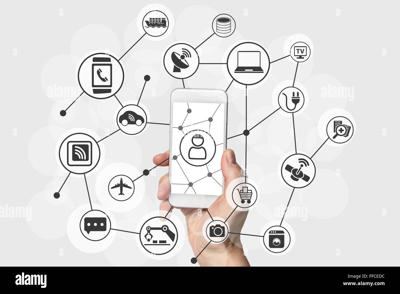 Internet of things (IOT) concept with hand holding modern smart phone - Stock Image