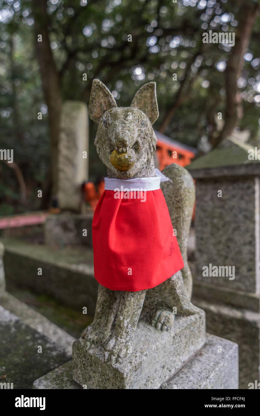 Statue at Fushimi Inari Shrine, Kyoto, Japan - Stock Image
