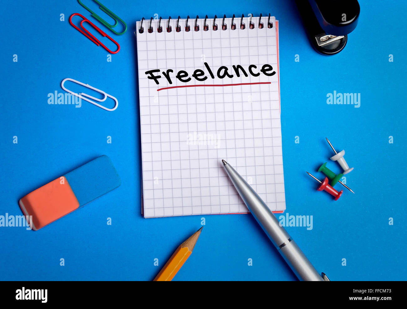 Freelance word on notebook page - Stock Image