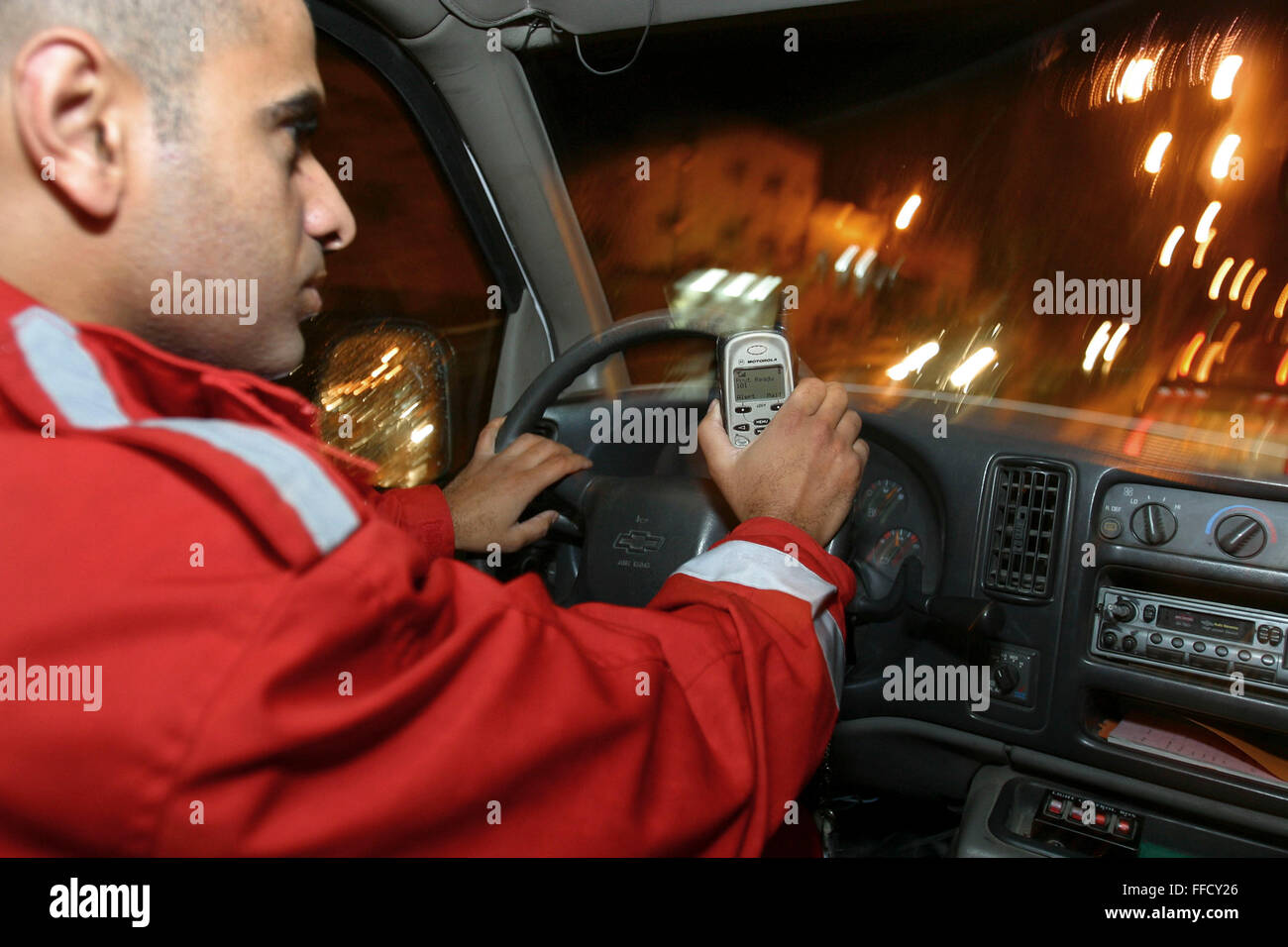 Alaa Hamad driving the ambulance in response to a 101 emergency call. Médecins Du Monde (MDM) and the Palestine - Stock Image
