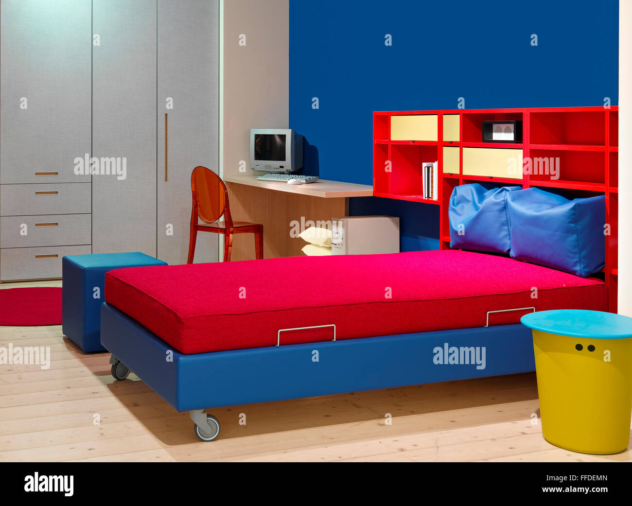 foreground of a red and blue bedroom in the modern children\'s ...