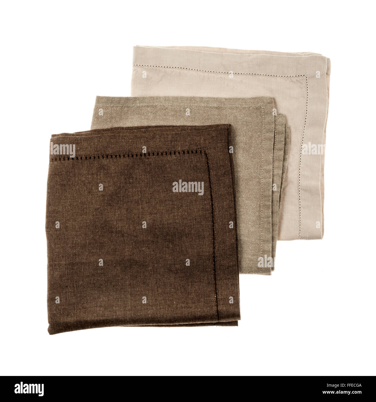 Linen cloth napkins in brown and beige natural colors isolated on white background - Stock Image