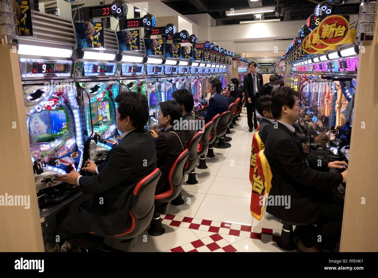 Japanese people playing pachinko, lottery, arcade game, video games, gambling, slot machines in Asian casino. Tokyo, - Stock Image