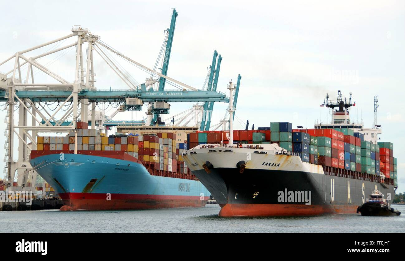 Two loaded container ships in the harbour of Miami, Florida - Stock Image