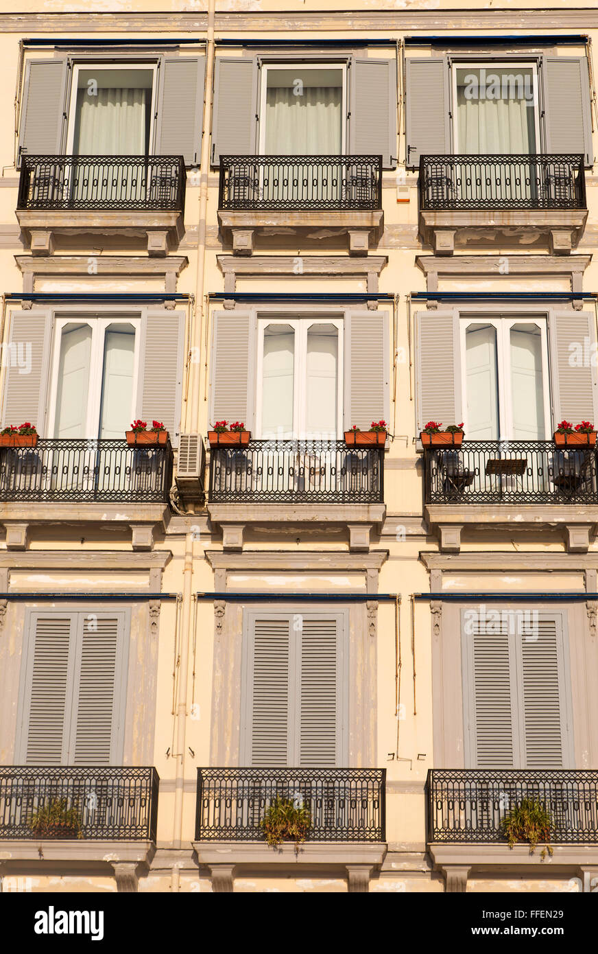 Symmetric balconies of a Liberty syle building - Stock Image
