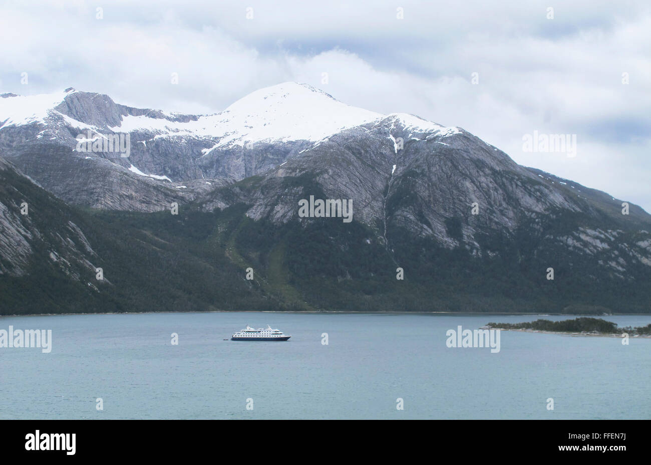 Patagonian landscape with lake and a cruise ship. Horizontal - Stock Image