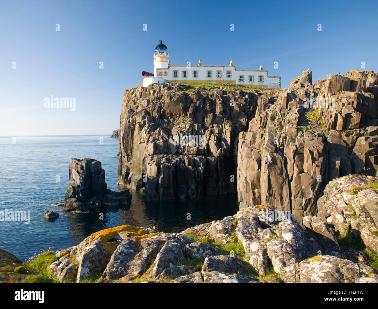 Glendale, Isle of Skye, Highland, Scotland. View from rocky headland to the clifftop lighthouse at Neist Point. Stock Photo