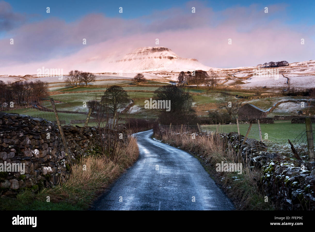 A misty winter view of Pen-y-ghent at sunset.One of the Yorkshire Dales Three Peaks, Horton in Ribblesdale, North - Stock Image