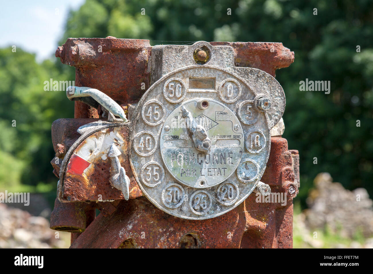 Rusting petrol pump in abandoned village of Oradour sur Glane, Haute Vienne, France - Stock Image