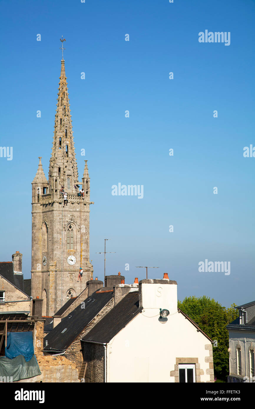 Abseiling from church spire, Britany, France - Stock Image