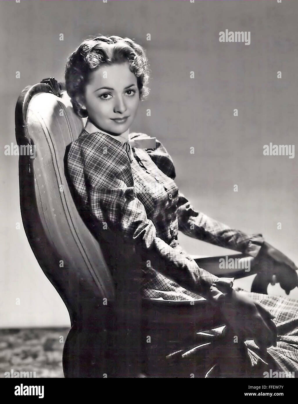 OLIVIA de HAVILLAND Anglo-American film actress in character for the 1938 film Dodge City - Stock Image