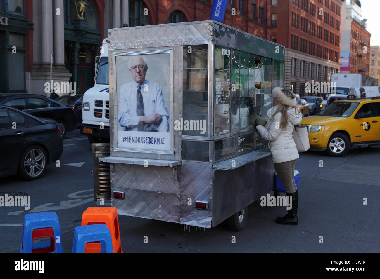 New York coffee cart displaying a photo endorsing US presidential candidate Bernie Sanders, Democrat Vermont - Stock Image