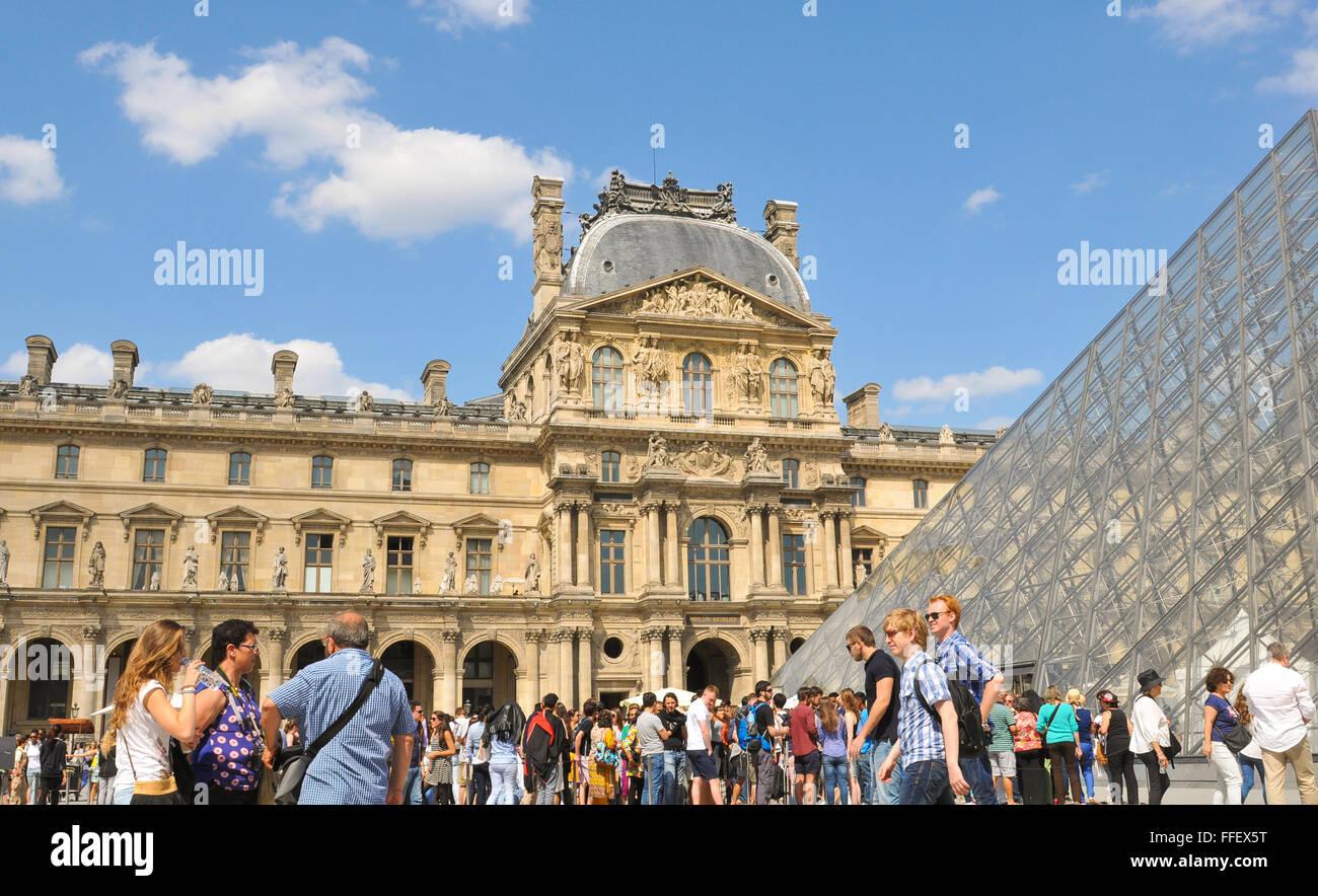 paris france july 9 2015 tourists visit the famous louvre stock