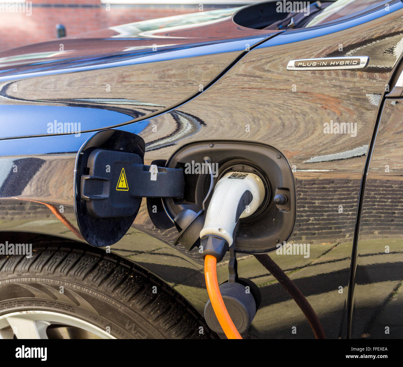 Plug in hybrid electric car charge point Stock Photo