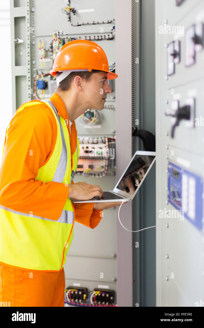 professional industrial technician checking transformer - Stock Image