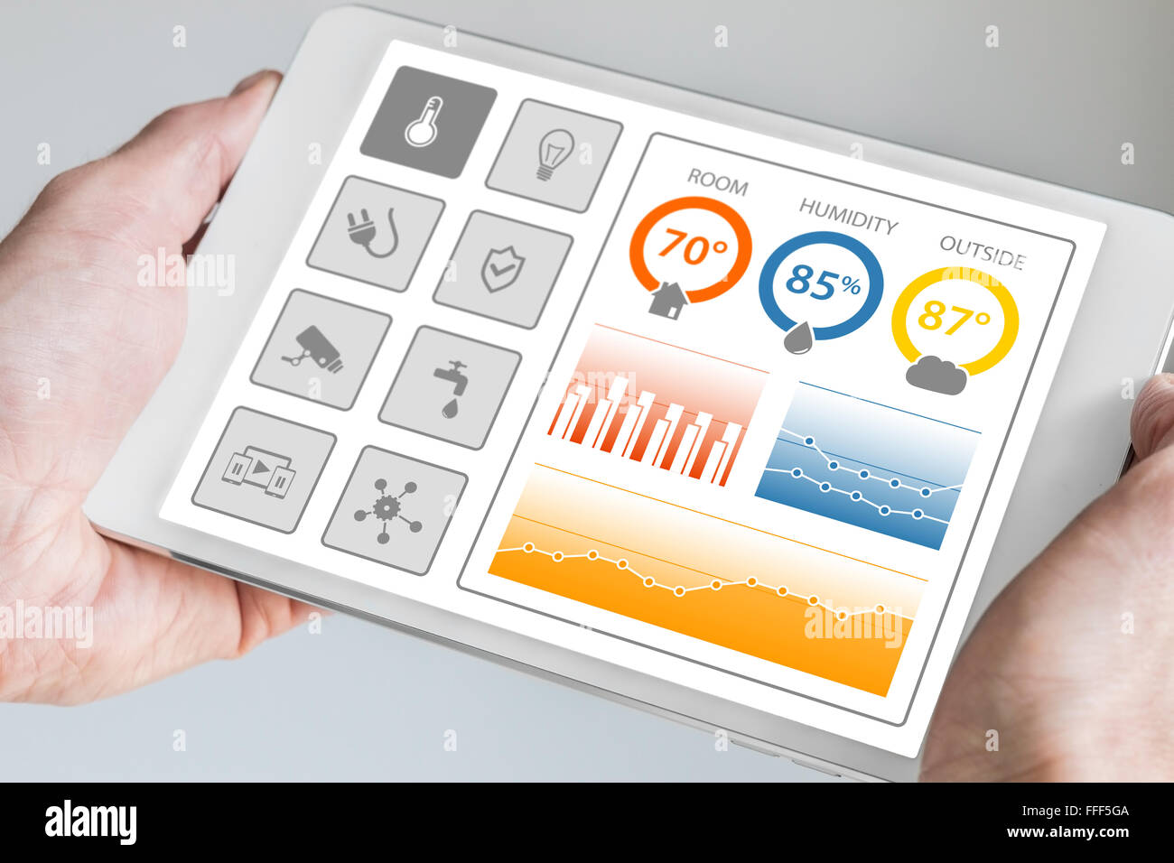 Smart home automation dashboard to control smart devices and sensors in the house or apartment. Hand holding modern - Stock Image