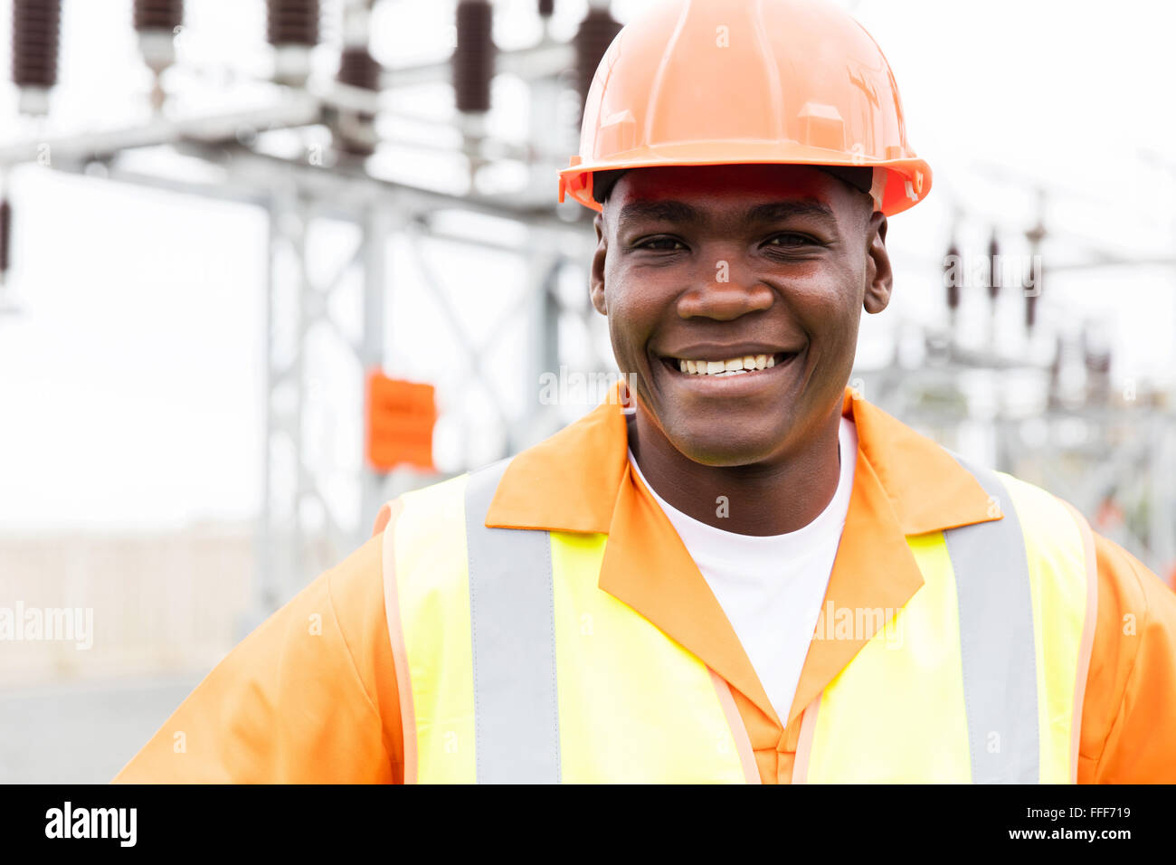 close up portrait of happy power company worker - Stock Image