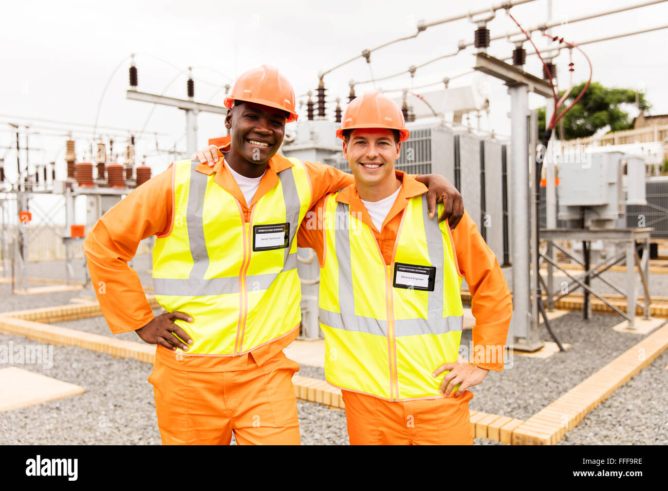 handsome electrical engineers standing in power plant - Stock Image
