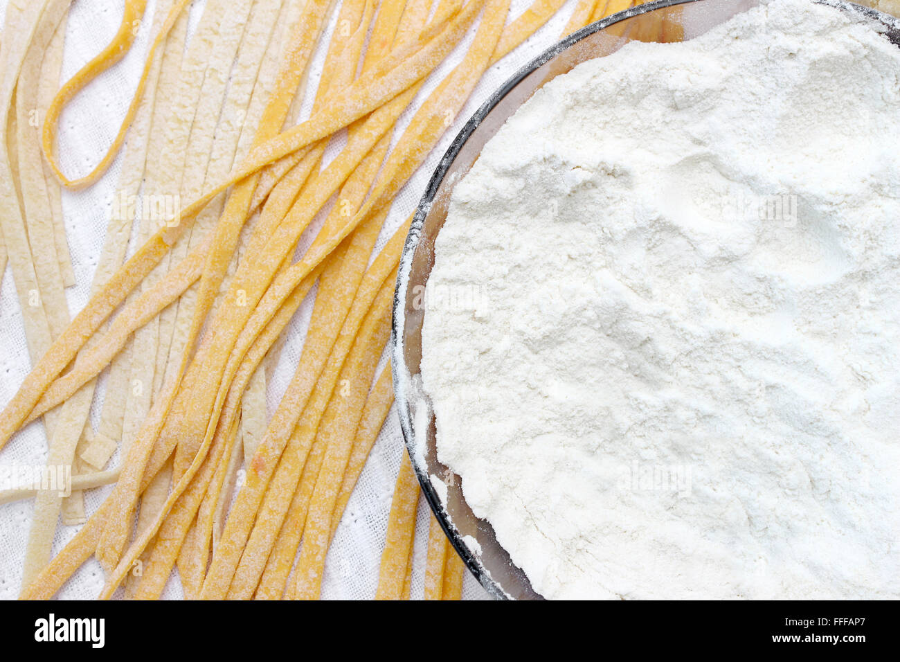 Fresh spaggeti with flour just been produced. - Stock Image