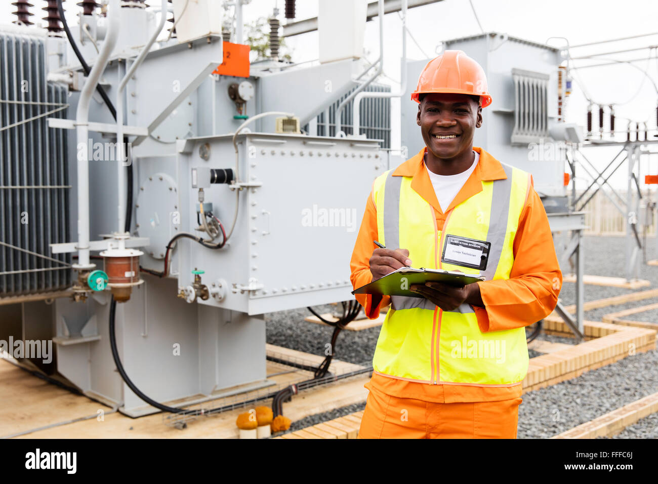 African technical worker working at power plant - Stock Image
