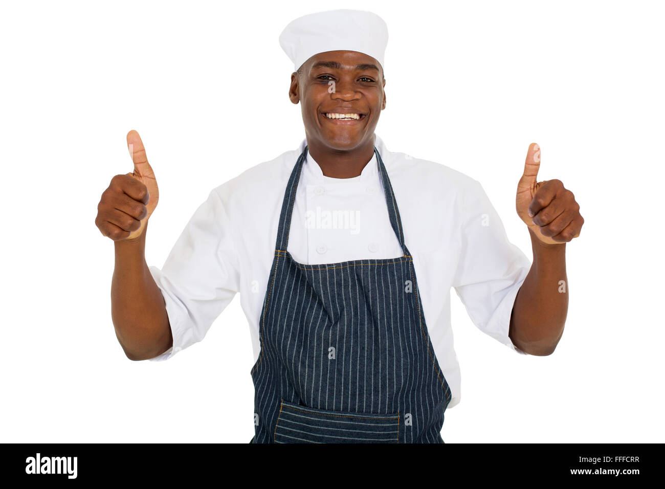 young African chef giving thumbs up - Stock Image