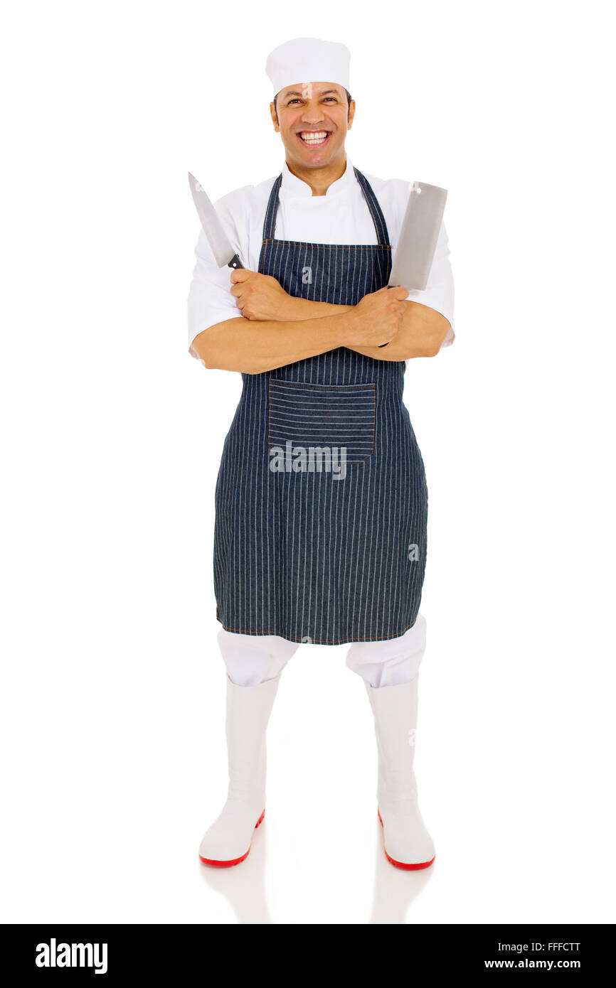 cheerful middle aged male butcher holding knives - Stock Image