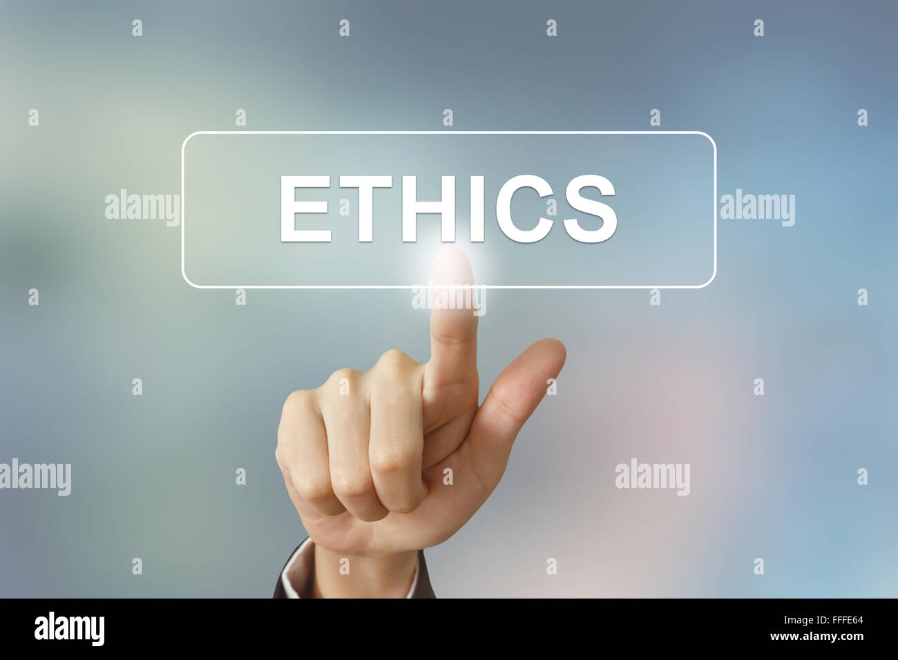business hand pushing ethics button on blurred background - Stock Image