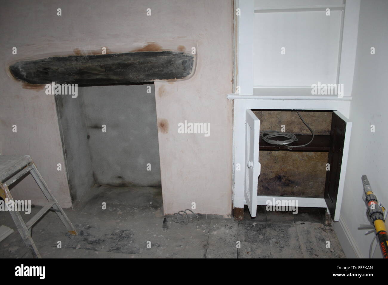 New plaster on walls in building renovation interior - Stock Image