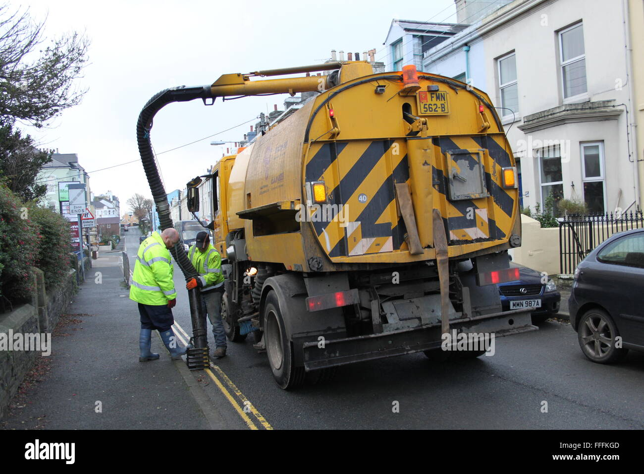 Clearing the drains to prevent flooding in Ramsey, Isle of Man - Stock Image