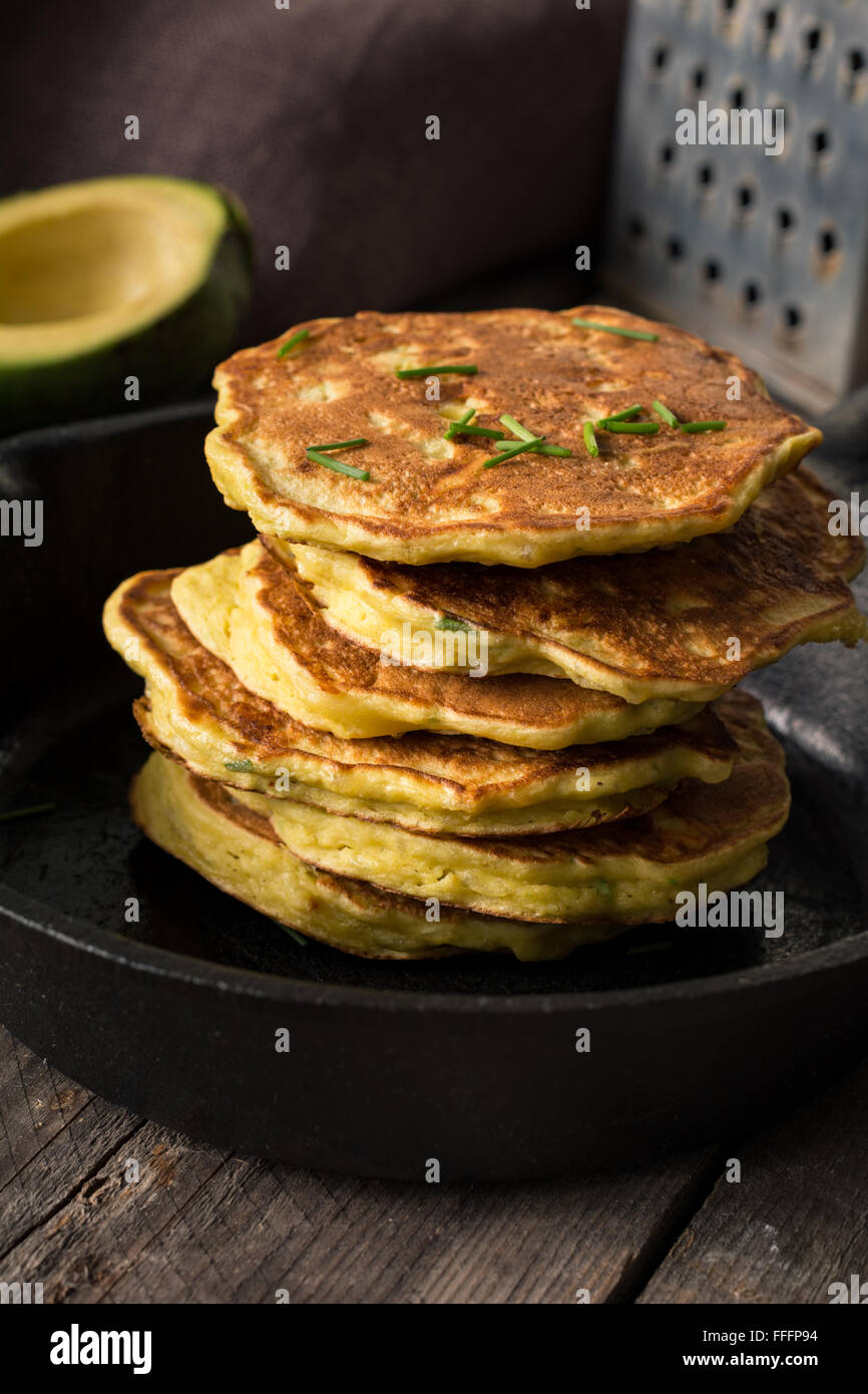 Stack of homemade savory vegetable pancakes / cabbage pancakes / zucchini pancakes / vegetable fritters with cheese. - Stock Image