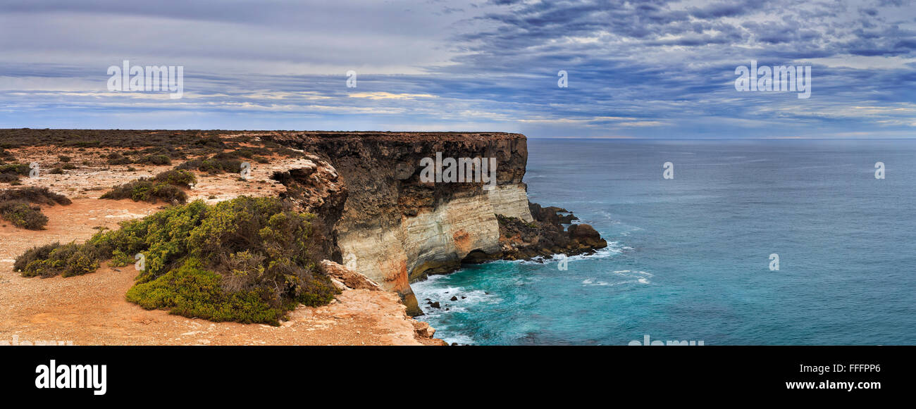 bushy and rugged coastline of South Australia as seen from Nullarbor geological limestone plain lookout towards - Stock Image