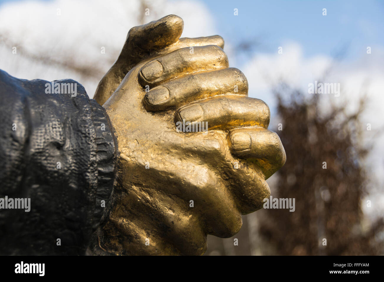 Hands clasped in prayer on the Sir Thomas Moore statue, Cheyne Walk, Chelsea, London, England, UK, - Stock Image